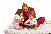 Mother With Kids Reading Story
