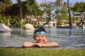 Smiling Kid In Swimming Pool