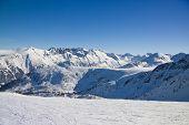 Ski Slope In Winter Mountains