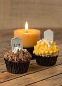 Halloween cupcake and candle close-up