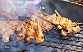 stock photo of thai cuisine  - Traditional Thai style grilled meat stick - JPG