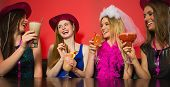 pic of hen party  - Chatting friends having stag party wearing stetsons and holding cocktails - JPG