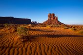 Monument Valley West Mitten Butte with desert sand dunes Utah