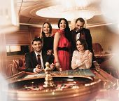 stock photo of roulette table  - Group of young people behind roulette table in a casino - JPG