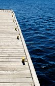 Wooden Dock On Blue Water