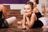 image of leotards  - Beautiful little dance student laying on the floor and taking a break in dance class - JPG
