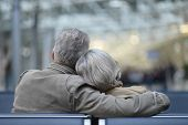 stock photo of bench  - Elderly couple relaxing on a bench - JPG