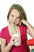 Teenage girl holding a cup with milkshake