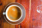Coffee Cup On Old Wooden Table