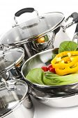 image of dutch oven  - Stainless steel pots and pans isolated on white background with vegetables - JPG