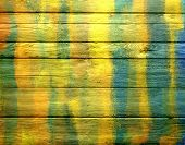 Colorful paint on old wooden fence