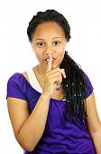 Isolated portrait of black teenage girl gesturing for quiet