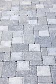Gray interlocking paving stone driveway from above