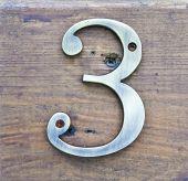 Brass Three On Wood