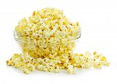 Bowl of fresh popped popcorn isolated on white background