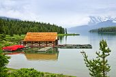 Canoes at boathouse on Maligne Lake in Jasper National Park, Canada