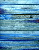 Blue grunge textured background on wood
