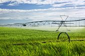 Industrial irrigation equipment on farm field in Saskatchewan, Canada