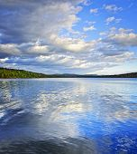 Lake of Two Rivers reflecting blue sky and clouds in Algonquin Park, Canada