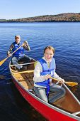 pic of canoe boat man  - Father and daughter canoeing on Lake of Two Rivers - JPG