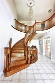 stock photo of entryway  - Curved oak staircase in luxury home entrance hall - JPG