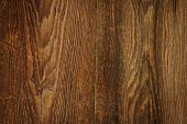 stock photo of woodgrain  - Brown rustic wood grain texture as background - JPG