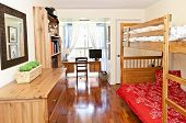 Student bedroom with hardwood floor and bunk beds - artwork is from photographer portfolio
