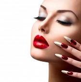 Fashion Beauty Model Girl. Manicure and Make-up. Nail art. Beautiful Woman With Red and Golden Nails
