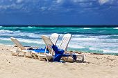 chaise longue on a beach on a background of ocean