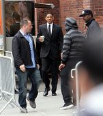 NEW YORK CITY - APRIL 15: Actor Will Smith carries a coffee cup on the set of Men In Black 3 (MIB3) which is being filmed in New York, NY on April 15, 2011.