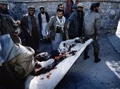 CHARIKAR, AFGHANISTAN - OCT 22: Mujaheddin fighters rush a Northern Alliance soldier to a hospital i