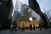 NYC - DEC 30: Pedestrians walk past an official Apple, Inc.  retail center in New York City, New Yor