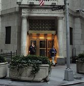 NYC - OCT 31: Two off-duty brokers stand by a back entrance to the New York Stock Exchange on Wall Street in New York City on Friday, October 31, 2008.
