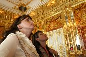ST. PETERSBURG - FEB. 19: Unidentified art lovers pour over an oil painting on display in the Amber Room in Catherine Palace near Saint Petersburg, Russia, on Monday, February 19, 2007.