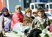 KUKES, ALBANIA, 18 APRIL 1999 --- Kosovar Albanians make their way into a refugee camp along the Alb