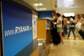 GERONA - October 21: Passengers line up at a check-in desk for Ryanair, the low budget carrier at Ge