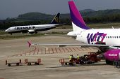 GERONA - SEPT. 6:  East European budget airline WizzAir on the tarmac at Gerona, Spain, on September