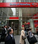 NEW YORK CITY - APRIL 19: Pedestrians walk past a Bank of America branch office  in New York City, o