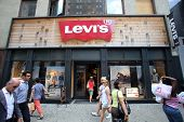 NEW YORK CITY - JULY 8: Shoppers walk past a Levi's retail clothing store in New York City, New York