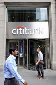 NEW YORK CITY - JULY 11: Pedestrians walk past a Citibank retail branch in lower Manhattan on Thursd