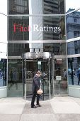 NEW YORK CITY - JULY 11: Pedestrians walk past the headquarters of Fitch Ratings in lower Manhattan