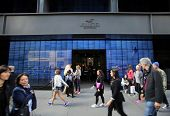 NEW YORK CITY - OCT 18:  Pedestrians walk past a a Hollister clothing store in Manattan on Friday, O