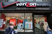 NEW YORK CITY - OCT 17:  Pedestrians walk past a Verizon Wireless retail outlet in Manhattan on Thur
