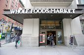 NEW YORK CITY - OCT 23 2013: Shoppers enter a Whole Foods Market supermarket in Manhattan on Wednesd