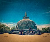 Vintage retro hipster style travel image of Kiri Vihara - ancient dagoba with grunge texture overlaid. Pollonaruwa, Sri Lanka