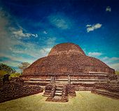 Vintage retro hipster style travel image of ancient Buddhist dagoba (stupe) Pabula Vihara with grung
