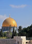 The golden dome of the mosque of Omar shines in the morning sun. Jerusalem, Israel