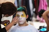 image of clown face  - Make up artist painting face of young clown - JPG