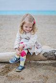 Cute Little Girl On The Coast