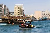 Abra Boat Transporting People Over The Dubai Creek